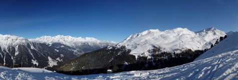 Alps Panorama. Panorama of snow-covered mountains in the Autrian Alps in winter Royalty Free Stock Photo