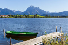 Alps panorama with lake, runway and boat Royalty Free Stock Images