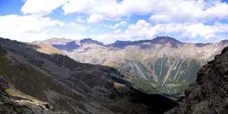 Alps. Panorama of alps tops with beautiful clouds Royalty Free Stock Image