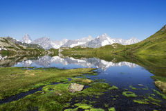 Alps Panorama at Window Lakes in Switzerland. Panoramic View of French Alps reflecting in one of the three Window Lakes (Lacs de Fenêtre) near the Swiss-French Stock Photos
