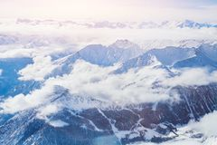 Alps, panoramic view of winter mountains. With clouds above seen from Punta Helbronner Royalty Free Stock Photos