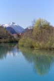 Mountains and trees reflection in the Lech river, Bavaria Royalty Free Stock Image