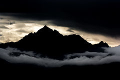 The Alps. Silhouette of a mountain at sunset in the Alps Stock Photo