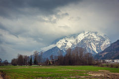 Alps in stormy clouds Royalty Free Stock Image