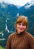 Alps summer mountain and woman portrait. Stock Image