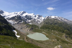 Alps in Switzerland with Glacier lake near Susten Stock Images