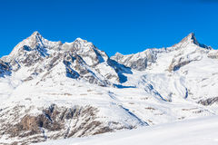 Alps on Switzerland-Italy border. View of the alps on Switzerland-Italy border near Matterhorn in winter on the hiking path royalty free stock images