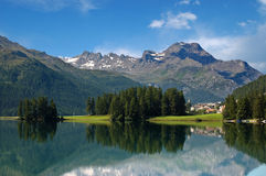 Alps in Switzerland - Silvaplana - St. Moritz. Swiss Alpine Landscape with lake, woodland and small town Stock Image