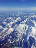 Alps Switzerland from the window of the plane Royalty Free Stock Photos