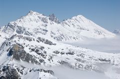 The Alps tops is wrapped in mist. Royalty Free Stock Photos
