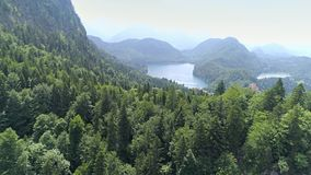 Alps Trees Valley Lakes Aerial 4k. Aerial footage of a beautiful lake in the Bavarian alps in Germany. This is in 4k quality stock video footage