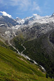 Alps Valley. A typical valley of the Alps with snow, glaciers, torrents,... This valley is located in Wallis, in the Zinal region Stock Image