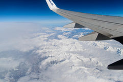 The Alps view in Austria from an airplane. An amazing view of the Alps in Austria from an aircraft. Birds flight angle Royalty Free Stock Photo