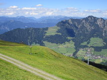 The Alps - View of fields and mountain peaks in Austria Royalty Free Stock Photo