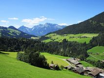 The Alps - View of fields and mountain peaks in Austria Stock Image