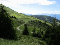 The Alps - View of mountain peaks and fields in Austria royalty free stock photography