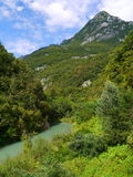 Alps view: river and single mountain. In Italy Royalty Free Stock Image