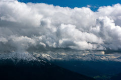 The Alps. View of the snowcapped Alps with clouds Stock Image