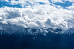 The Alps. View of the snowcapped Alps with clouds Royalty Free Stock Photo