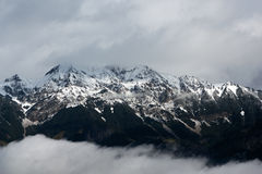 The Alps. View of the snowcapped Alps with clouds Stock Photos