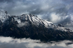 The Alps. View of the snowcapped Alps with clouds Royalty Free Stock Image