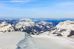 The Alps, view from the top of Mt. Titlis in Switzerland. In the very beginning of spring. The Titlis is a mountain, located on the border between the Swiss Royalty Free Stock Photo