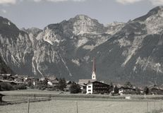 The Alps - View of a village and mountain peaks in Austria Royalty Free Stock Image