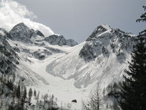 Alps. View of a winter mountain landscape with snow and avalanche Royalty Free Stock Image