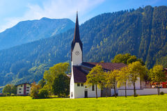Alps village with cathedral Stock Photography