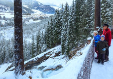 Alps waterfall winter view and family Royalty Free Stock Photo