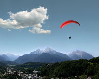 Alps: Watzmann, Berchtesgaden & Paraglider. Very beautiful landscape in the german Alps with the mountains Watzmann and Hochkalter, a Para glider and the village stock photography