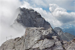 Alps - Watzmann peak (2713) in the cloud from summit of Hocheck Royalty Free Stock Photos