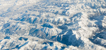 The Alps in winter out of the plane Stock Image