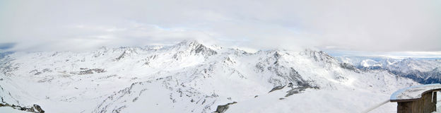 Alps Winter Panorama. French Alps Winter Panorama taken during foggy day Royalty Free Stock Images