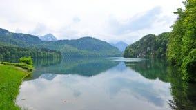 Alpsee sjö i Tyskland Arkivbild