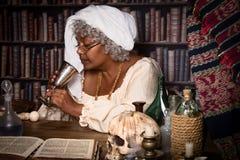Alquimista con cáliz Fotografía de archivo libre de regalías