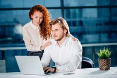 We already have great results. woman pointing at laptop Stock Images