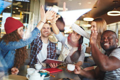 Alright guys. Group of young friends enjoying spending time together royalty free stock photo
