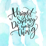 Alright spring, do your thing. Inspiration quote about spring coming. Modern calligraphy at pastel blue watercolor Stock Images