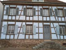 12 67 5000 02 Alsace facade with stairs. Front frontage frontal home dwelling domicile tenement Window casement Wood timber Portal gate Stock Photo