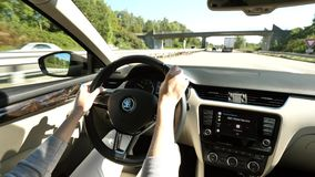 Woman inside car Skoda electric vehicle steering wheel. Alsace, France - Circa 2018: Woman POV driving electric Skoda car - view car interior to the road with stock video footage