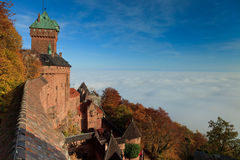Alsacian castle view with clouds. The castle Haut-Koenigsbourg from Alsace region in France, Europe above the clouds Royalty Free Stock Images