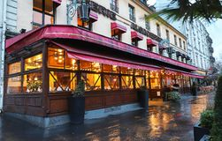 The Alsatian brasserie Chez Jenny at rainy morning . It is traditional French brasserie located near Republic square in. Paris, France-March 10, 2019 : The stock images