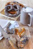 Alsatian Bretzels and mug of beer. Traditional alsatian pastry: Assortment of  Alsatian Bretzels and mug of beer Royalty Free Stock Photography