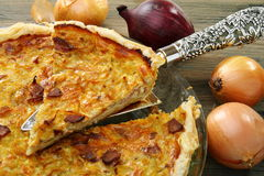 Alsatian onion pie with ham. Royalty Free Stock Photo