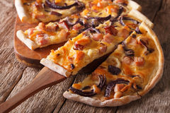 Alsatian pie flammkuchen chopped close-up. Horizontal Royalty Free Stock Photos