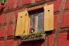 Alsatian window. Colourful window in old stile home Alsace, France royalty free stock images