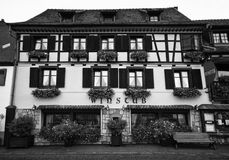 Alsatian winstub. A typical Alsatian wine house (winstub), black and white image royalty free stock photography