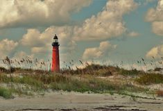 Ponce Inlet Lighthouse from New Smyrna Beach royalty free stock image