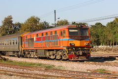 Alsthom Diesel locomotive no.4102. CHIANGMAI, THAILAND- FEBRUARY 5 2014: Alsthom Diesel locomotive no.4102 and train no.52 from chiangmai to bangkok. Photo at Stock Photography